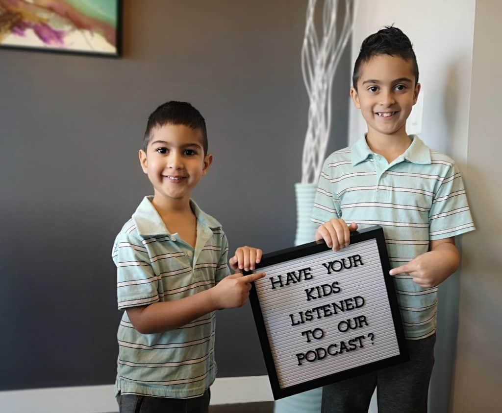 Photo of kids holding sign saying Have you listened to our podcast